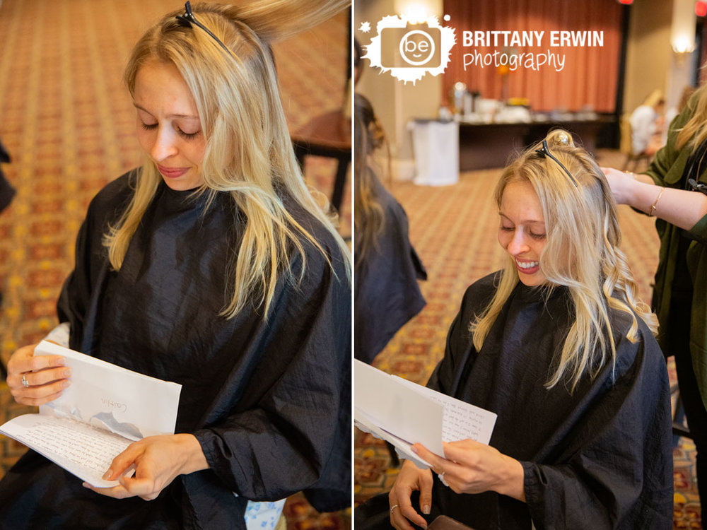 bride-reading-letter-from-groom-while-getting-ready-morning-at-union-station.jpg