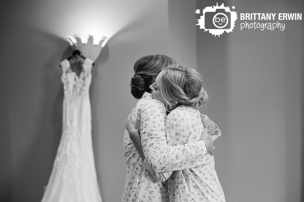 Indianapolis-wedding-photographer-bride-with-mother-hug-with-dress-in-background.jpg