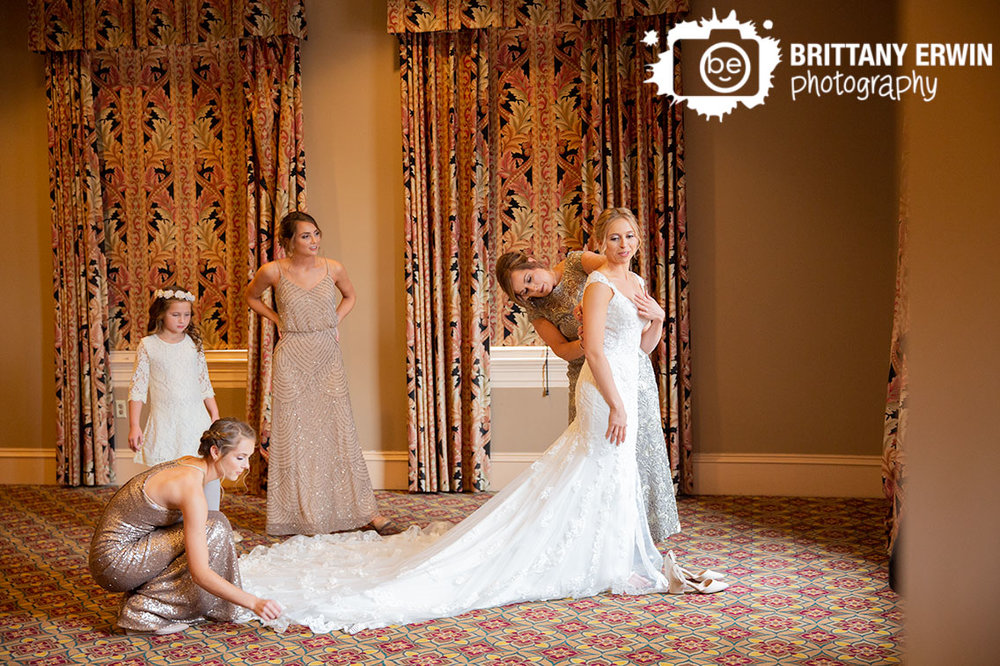 Union-Station-Indianapolis-wedding-photographer-bride-getting-ready-sisters-mom-helping-with-dress.jpg