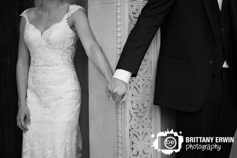 Indianapolis-portrait-wedding-photographer-wedding-gown-couple-hold-hands-around-corner.jpg