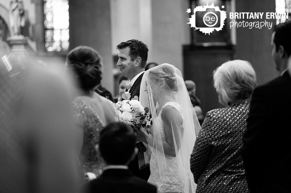 Indianapolis-wedding-ceremony-father-of-bride-walking-down-aisle-with-bouquet-veil-covered.jpg