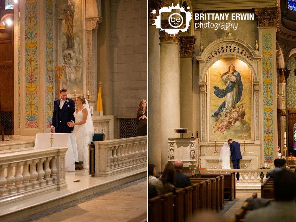 Catholic-wedding-ceremony-flowers-to-mary-couple-at-altar.jpg