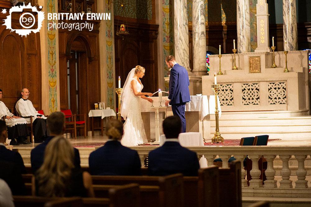 unity-candle-couple-at-altar-catholic-ceremony.jpg