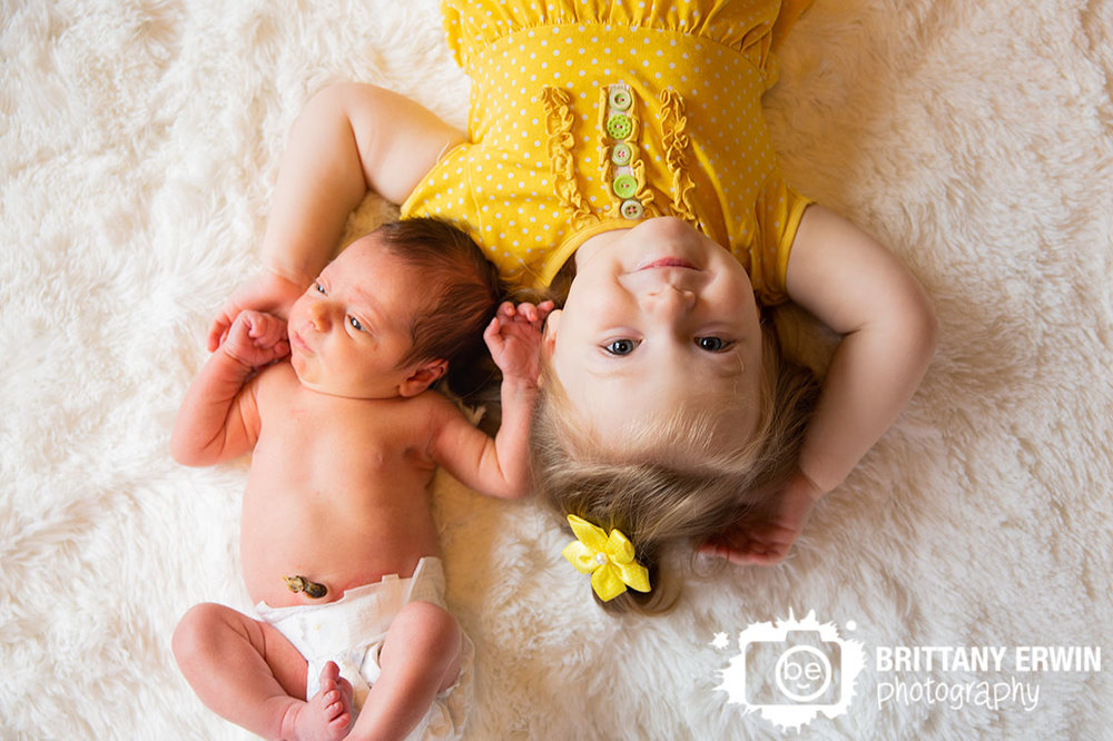 Indianapolis-newborn-portrait-photographer-in-home-lifestyle-session-brother-sister-on-furry-blanket.jpg