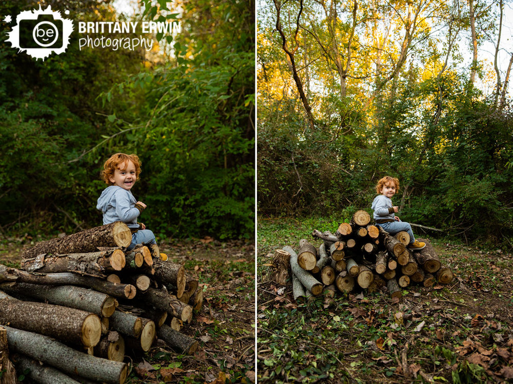 Indianapolis-fall-toddler-boy-portrait-photographer-laughing-sitting-on-firewood-logs.jpg