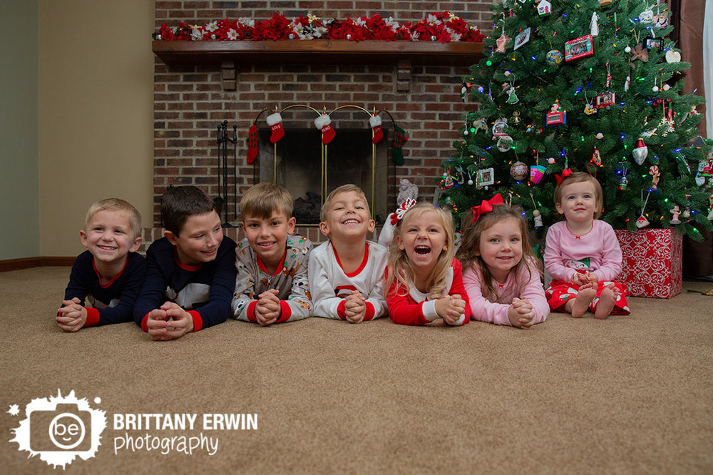 Lifestyle-christmas-portrait-photographer-in-home-cousins-with-tree-fireplace.jpg