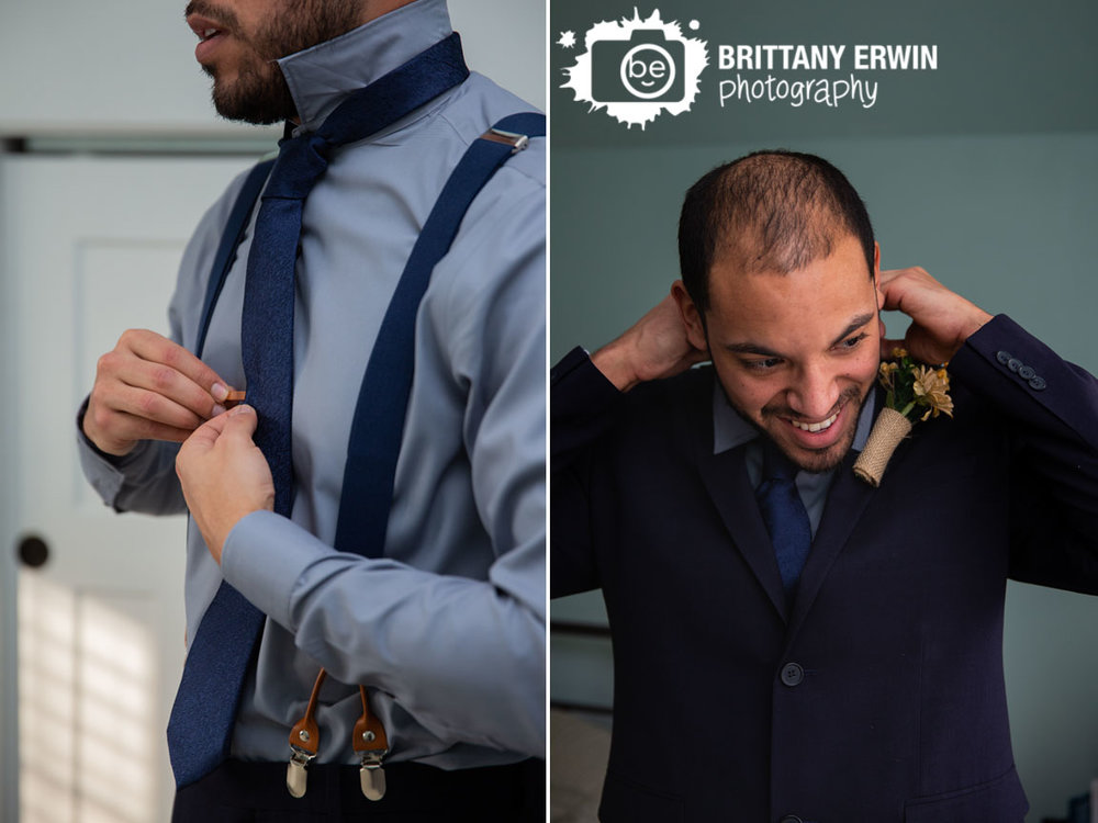 Indianapolis-photographer-groom-getting-ready-suspenders-tying-ite.jpg