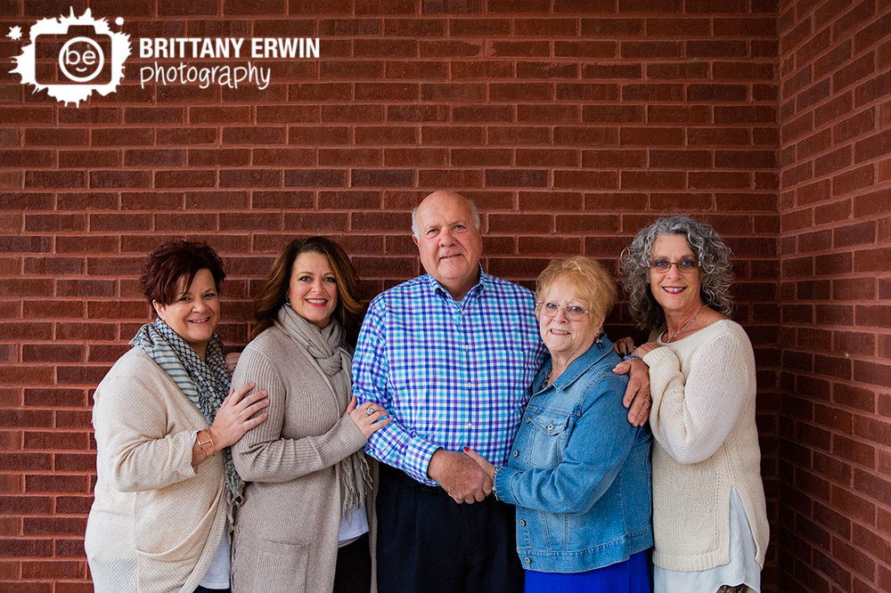 Family-portrait-sisters-with-parents-brick-wall-Franklin-Indiana-photographer.jpg
