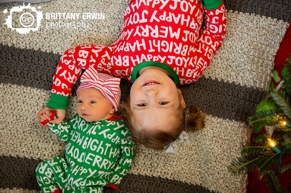 Indiana-newborn-in-home-lifestyle-siblings-sisters-matching-christmas-pajamas.jpg