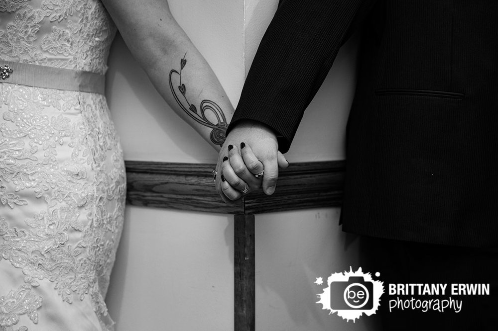 Bride-and-groom-holding-hands-around-a-corner-before-the-ceremony.jpg