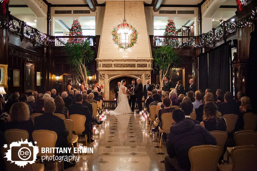 Indianapolis-fireplace-christmas-wedding-inspiration-couple-under-wreath.jpg