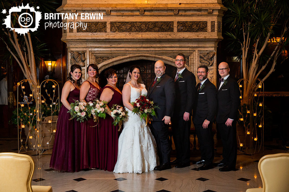 Columbia-Club-wedding-photographer-bridal-party-at-fireplace-group-maroon-dress.jpg