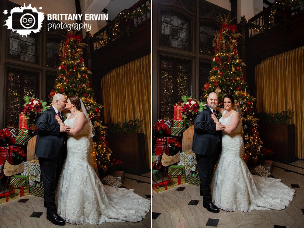 Christmas-wedding-tree-with-presents-columbia-club-bride-groom-kiss.jpg