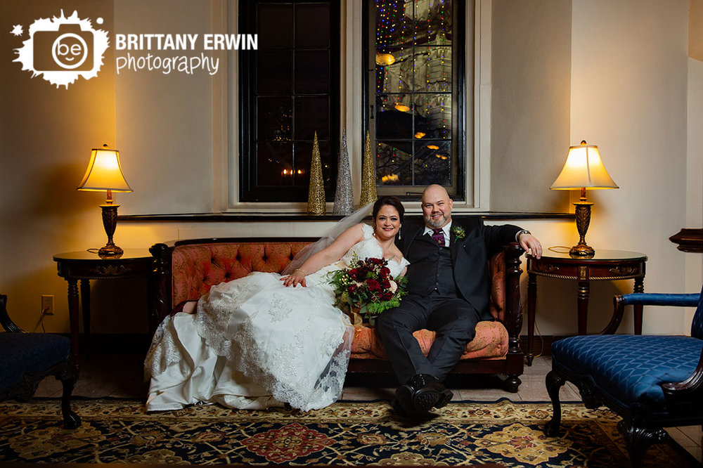 Downtown-Indianapolis-wedding-photographer-bride-groom-on-antique-couch-columbia-club.jpg