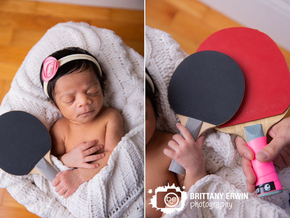 Indianapolis-newborn-baby-girl-holding-ping-pong-table-tennis-paddle-with-dad.jpg