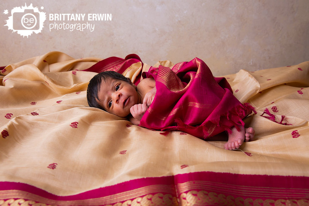 baby-girl-wrapped-in-saree-Indianapolis-newborn-photographer.jpg