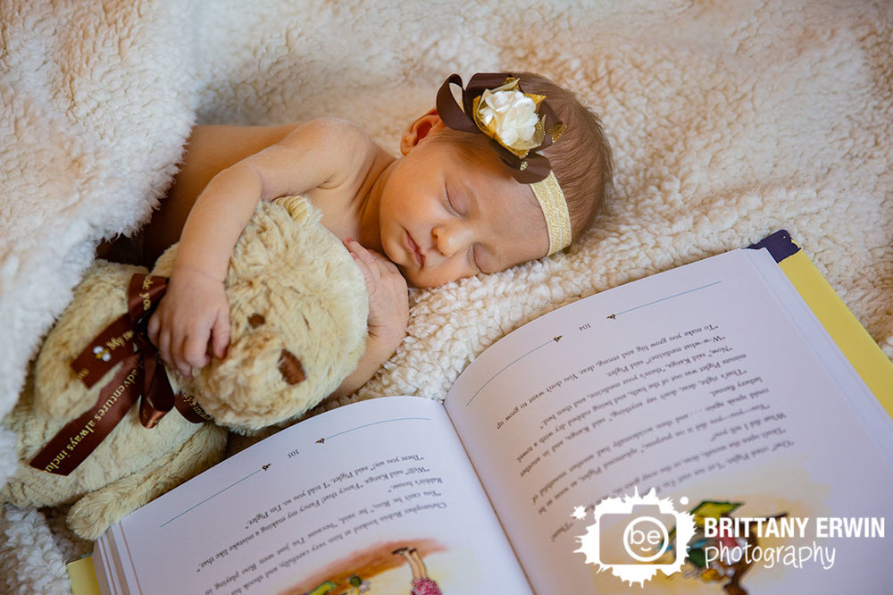 Indianapolis-in-home-newborn-lifestyle-portrait-photographer-winnie-the-pooh-sleeping-on-book-with-bear.jpg