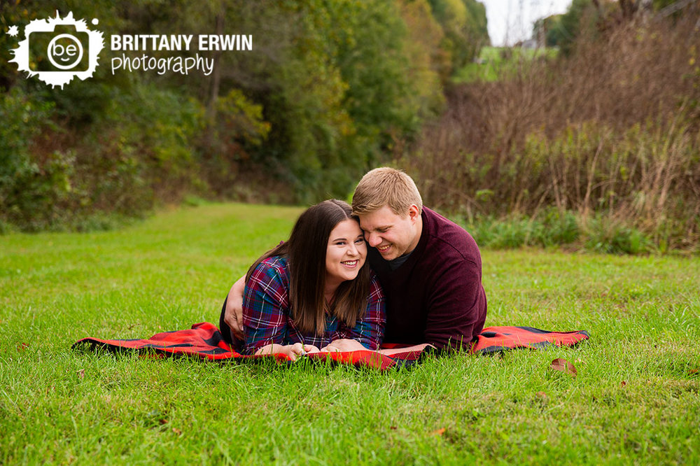 camby-Indiana-engagement-portrait-photographer-couple-on-picnic-blanket-fall-session.jpg