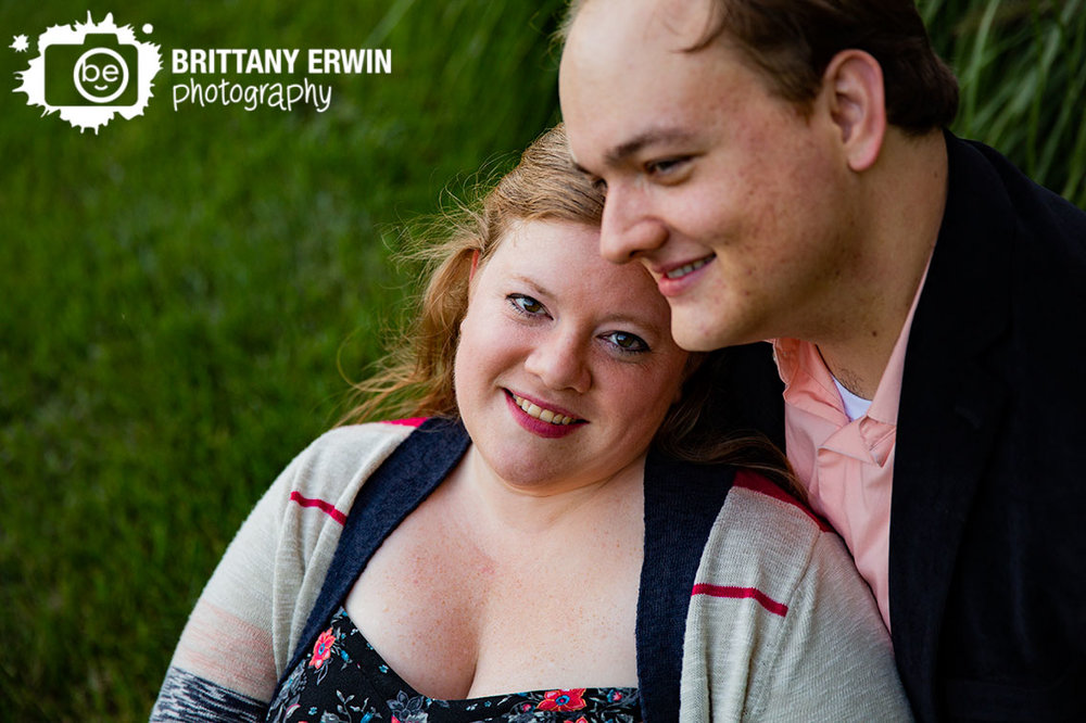 Bloomington-Indiana-engagement-portrait-photographer-couple-sit-together-in-grass.jpg
