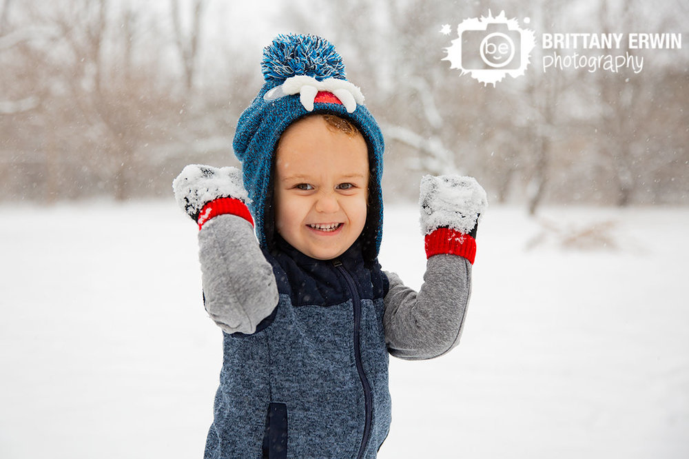 Indianapolis-boy-toddler-playing-silly-face-snow.jpg