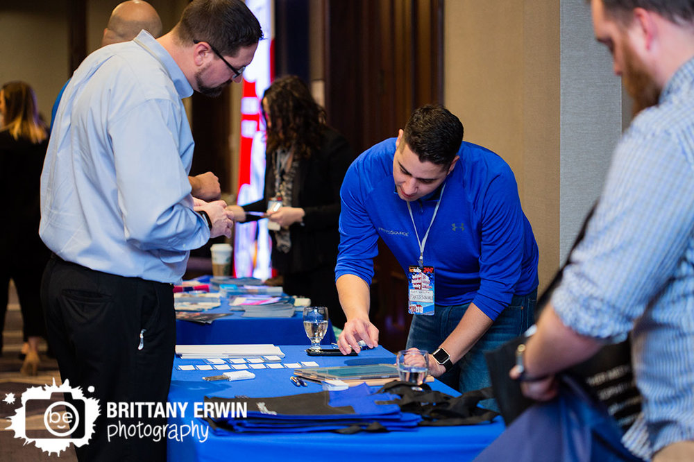 Indianapolis-event-photographer-booth-talking-with-attendee-Indiana-Biomedical-Society.jpg
