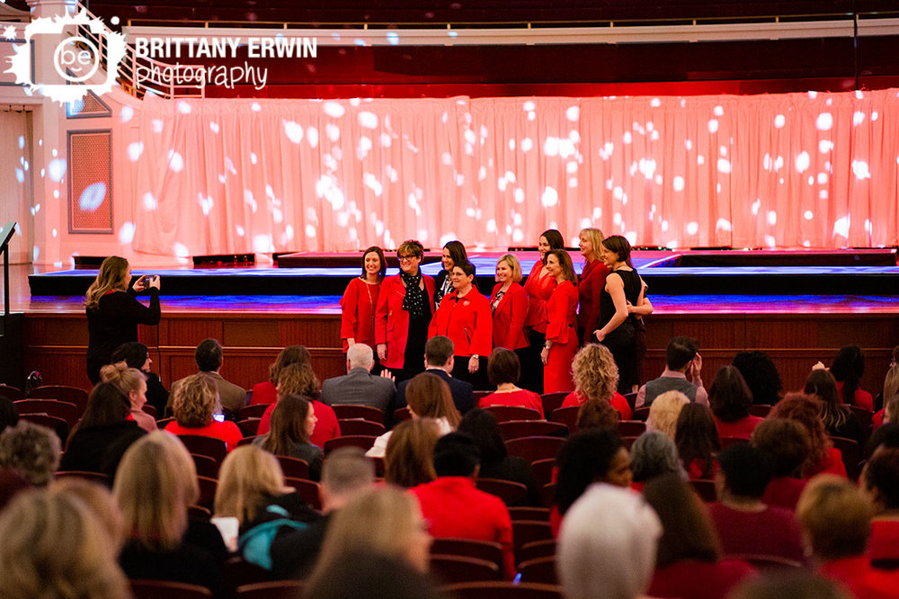 Indianapolis-event-photographer-group-at-AHA-go-red-for-women-luncheon-at-the-Palladium-near-stage.jpg