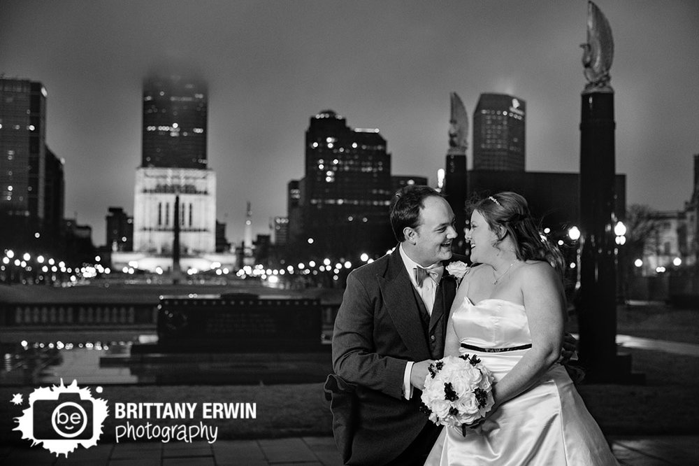 Indianapolis-downtown-central-library-wedding-photographer-couple-with-skyline-monument-circle-war-memorial.jpg