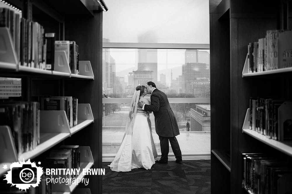 Indianapolis-couple-kiss-with-skyline-central-library-book-shelves.jpg
