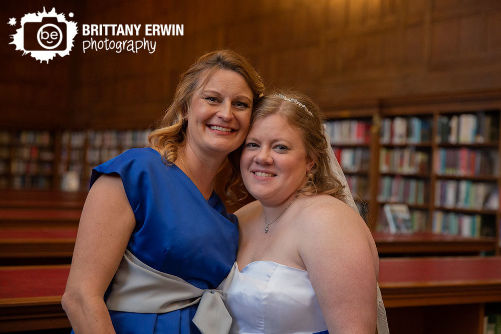 Indianapolis-wedding-photographer-bride-with-maid-of-honor-central-library-in-simon-reading-room.jpg