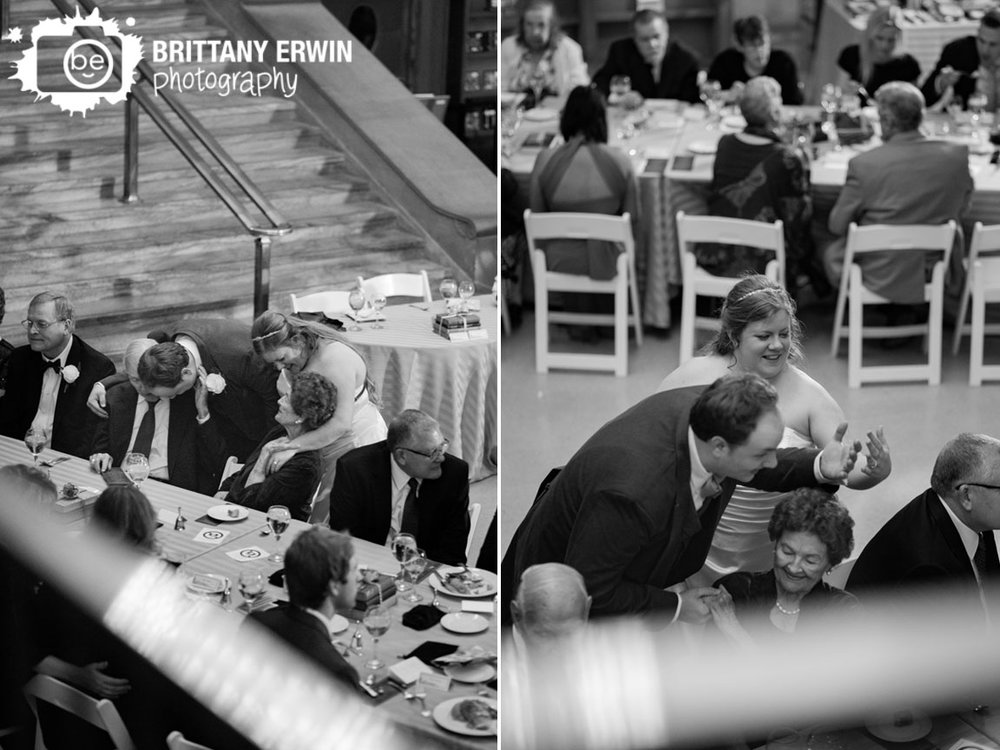 Indianapolis-Central-Library-wedding-photographer-couple-visit-tables-at-reception-hug.jpg