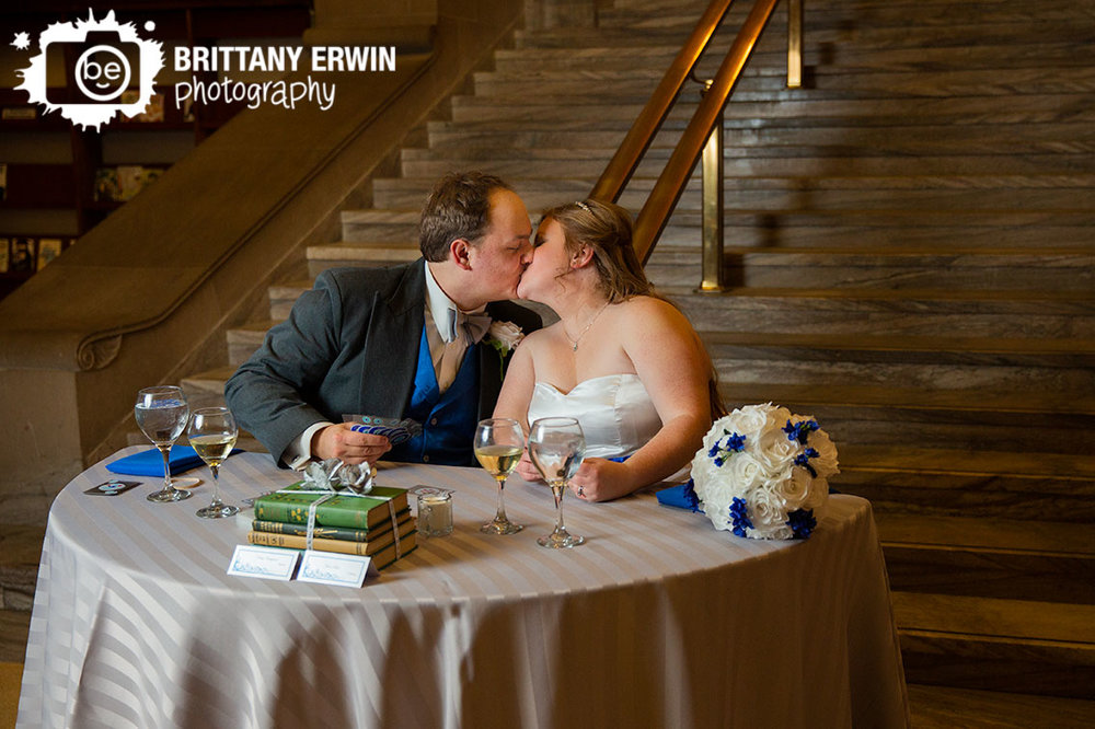 Indianapolis-Central-Library-couple-kiss-head-table-first-game-playing-cards-at-reception.jpg