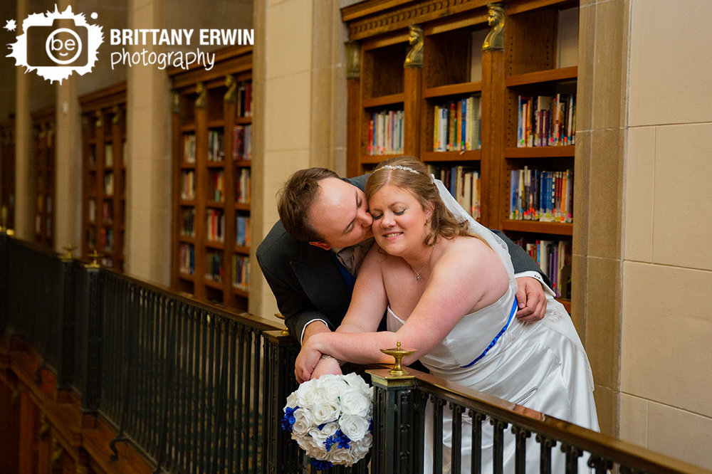 Indianapolis-central-library-wedding-photographer-couple-with-book-shelves-railing.jpg
