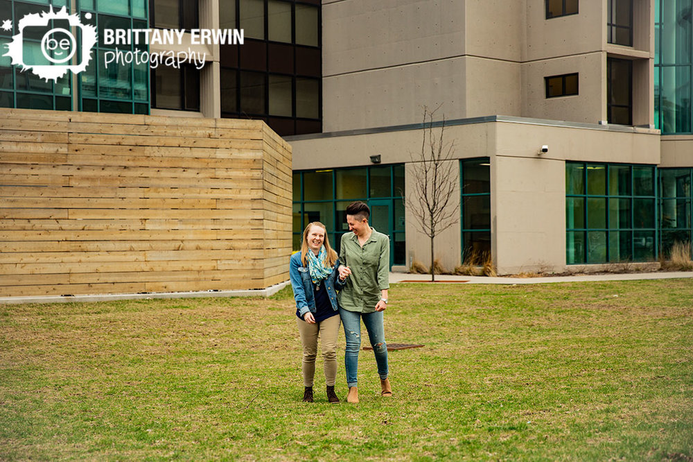 Indianapolis-engagement-portrait-photographer-couple-walking-together-laughing.jpg
