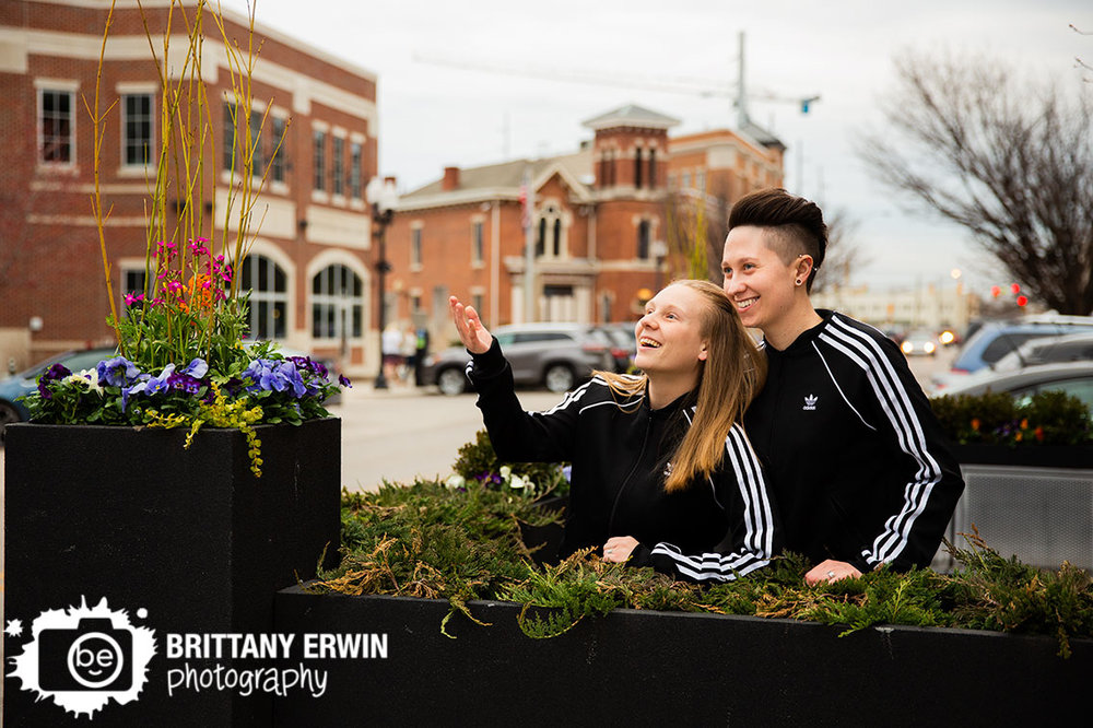 Indianapolis-engagement-photographer-silly-fun-couple-matching-track-suits-spring-flowers.jpg