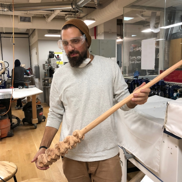 Here we have  MFA Fine Arts  student Kenstantinos Lales, hand carving a large hair pin from wood for on of his art projects. He demonstrated a lot of patience and learned many new wood working skills from this project.