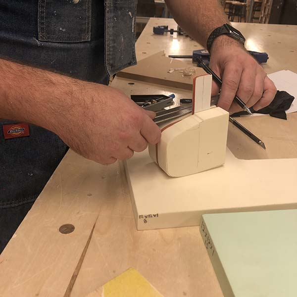 Bart designed a pyro mallot that creates fire using the fire piston mechanism. His final model is made of dense foam and acrylic using tools in the woodshop.