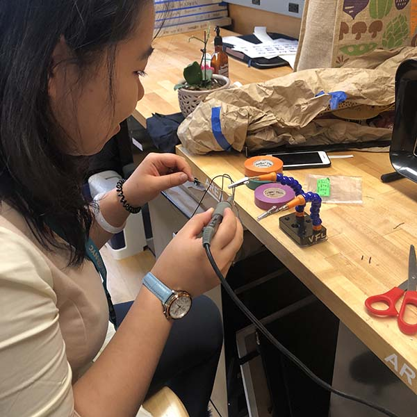Leng, Sherry, and Anna of  Products of Design MFA  are working on a Halloween costume for their Making Studio class. For this class, they are sewing together an adorable pink penguin which they'll embed an interactive circuit with Arduino and LEDs.