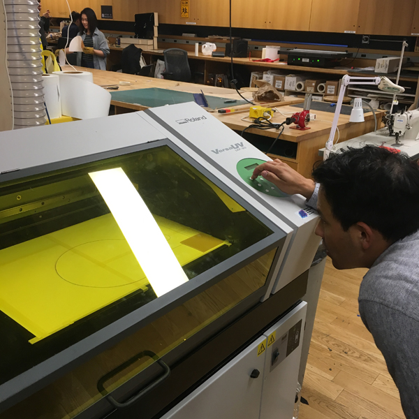 First-year  MFA Photography, Video, and Related Media  student Esteban Kuriel is using the UV printer to produce a backlit image for a viewfinder, as part of his department's Related Media class taught by VFL alumni Tak Cheung.