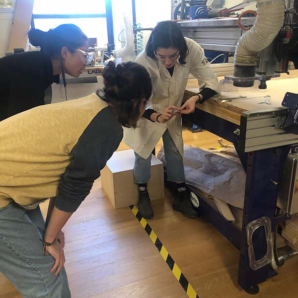 Eu Ramos Alonso and Qixuan Wang, second year students of the  SVA Products of Design  Program, are receiving a refresher on how to use the ShopBot CNC Machine.