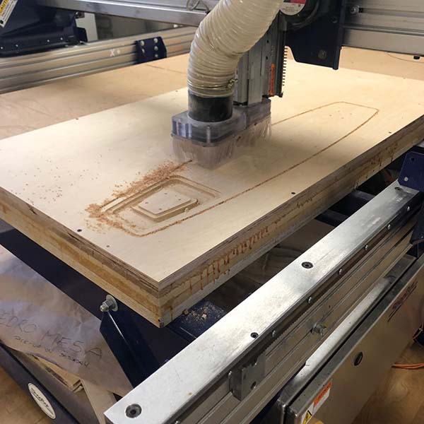 They are using the CNC machine to make a longboard for their branding course that will illuminate the rider and improve visibility.