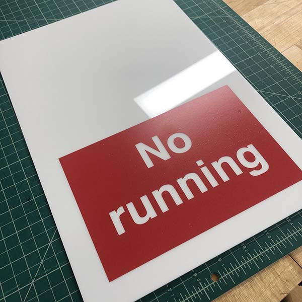 She used the Roland vinyl printer to make the red and black stickers to apply on a laser-cut piece of acrylic. Anyone want to guess where it will be put up?