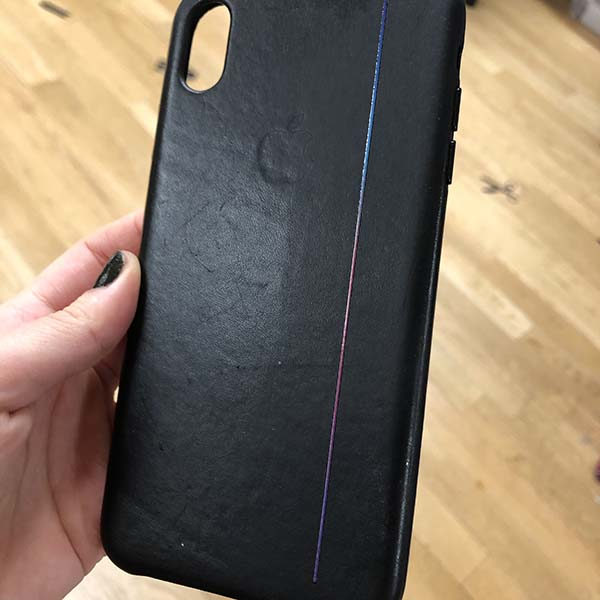 After some tweaks, she printed onto a leather iPhone case a gradient bar that is comprised of three layers. White to make the colors pop, CMYK for the image, and a layer of gloss to top it off