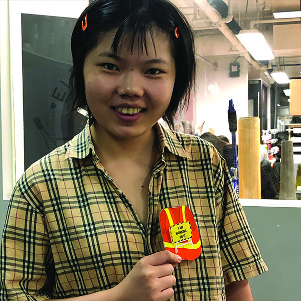 Touching people's hearts was the assignment that was given to her class and she is creating souvenirs for 'men at work', who dedicate their lives for the service of their city.