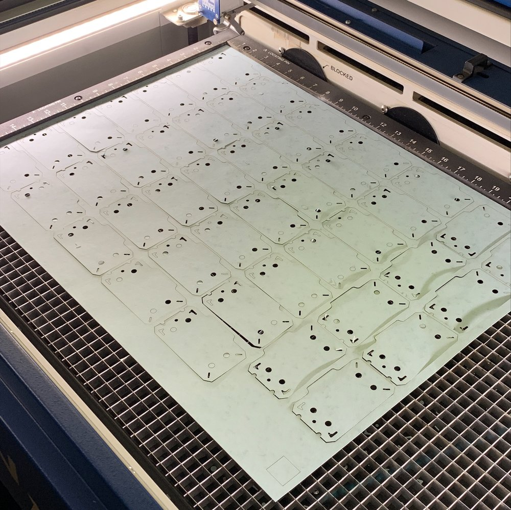 Jimmy Mezei is a 1st year  MFA Fine Arts  student. He is cutting business cards using the VFL's Laser Cutter.