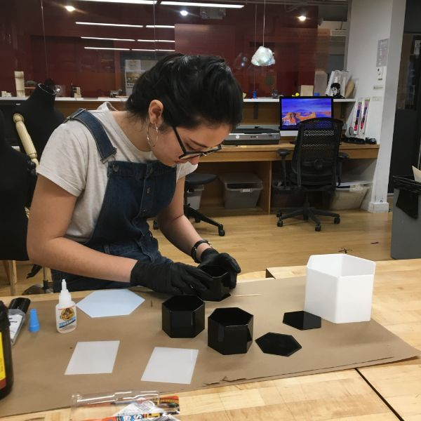 MFA Design  first year Jennifer Holcomb is designing a set of nesting produce containers for her Design Decisions course. She's using the VFL's laser cutter and plastic bender to create a realistic prototype exploring form and color.