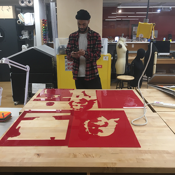 Second-year  MFA Design  student Mitchell Reece came in today to cut detailed silhouettes out of acrylic plastic using the laser cutter.