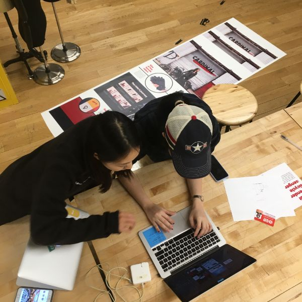 Phuong Anh and Seona are in the lab printing banners for the upcoming  Products of Design  gallery show.