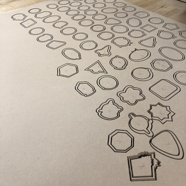 He's doing this by first creating a vector file and then using the Shopbot CNC router to cut the shapes.