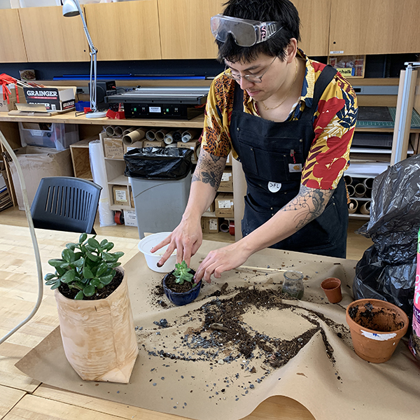 Prototyping specialist  Chester Dols  (note the safety glasses!) is putting his green thumb to use here in the VFL repotting plants and making sure they are healthy. Our plant collection sets the mood in the maker space.