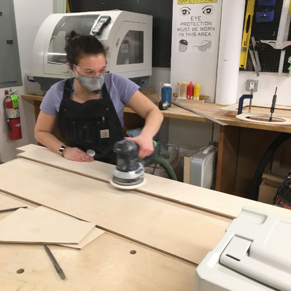 The notes they leave behind will then be sent to the NYC mayor's office. Hannah ripped all of the wood on the table saw with the help of VFL staffer Elizabeth and fellow Products of Design second year Carly. She is using the Festool orbital sander to prep the pieces and keep the shop clean.